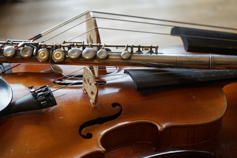 Photo of a flute, violin and cello
