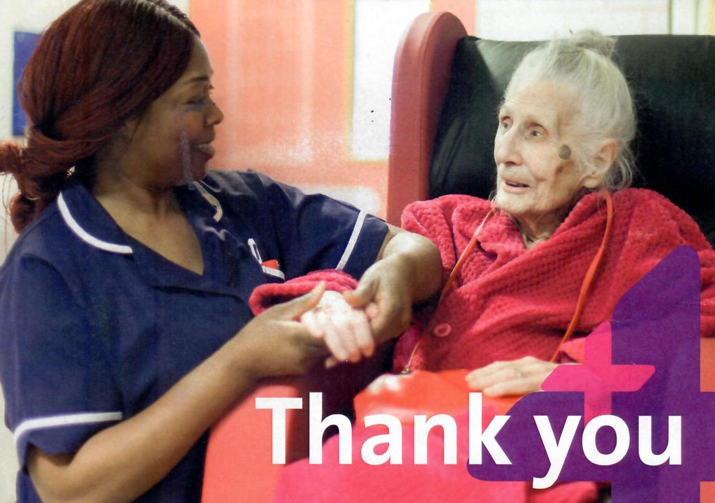 Image of elderly patient with nurse on a card with the word 'Thank you'